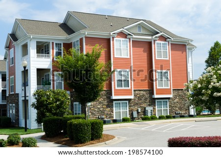 Typical apartment building in suburban area  - stock photo