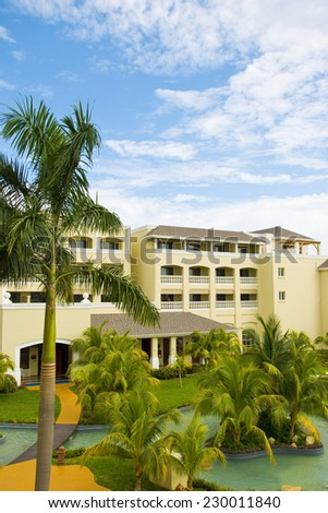 Typical architecture building beach palm trees Carribean resort - stock photo