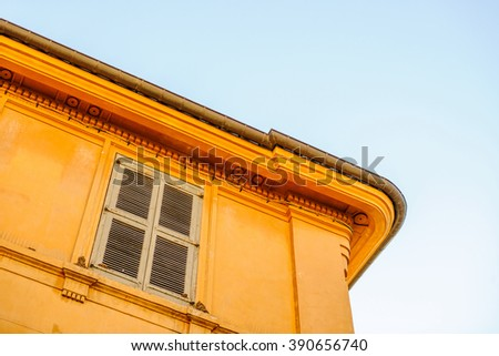 Typical architecture detail of a red painted house in the Provence region, France, city of Aix-en-Provence - stock photo