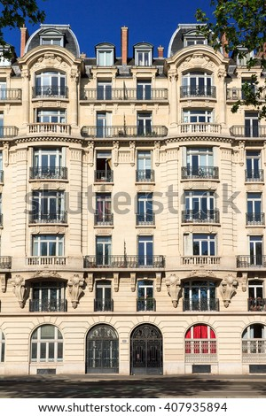 Typical architecture facade of an apartment building in Paris, France - stock photo