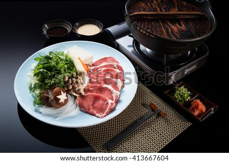 Typical Asian dish with marble noodles, bacon, tofu, mushrooms and greens on a plate. Asian food. - stock photo