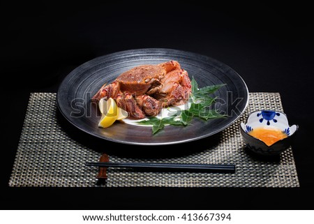Typical Asian seafood dish a crab and lemon on a plate and sweet sauce. Asian food. - stock photo