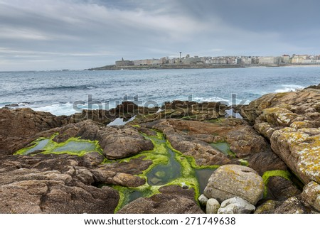 Typical Atlantic coast, with the background of the city of A Coruna, Spain - stock photo