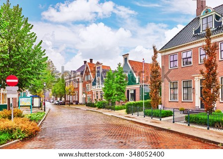 Typical, authentic village with cozy houses of the  countryside in the Netherlands.  - stock photo