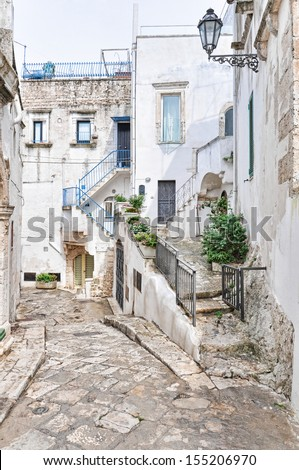 Typical back alley of Ostuni's old town in Apulia. It's called also the white town.