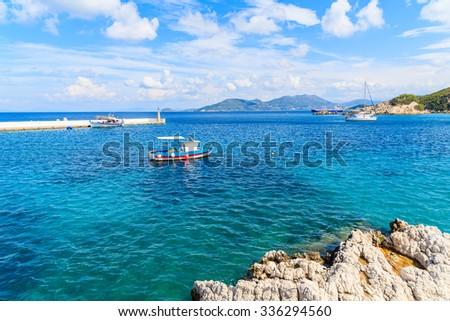 Typical blue and white colour fishing boat on sea in Kokkari bay, Samos island, Greece - stock photo