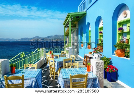 Typical blue and white Greek restaurant, Kalymnos, Dodecanese Islands, Greece - stock photo