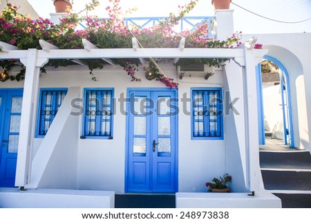 Typical blue door with stairs. Santorini island, Greece - stock photo