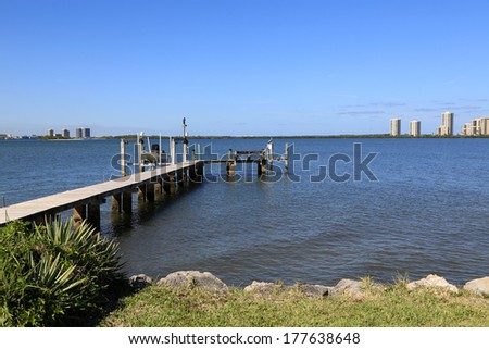 Typical boat dock and hoist in South Florida - stock photo