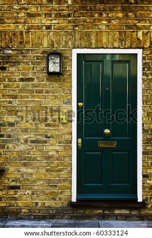 Typical British door with doorbell in West London. - stock photo