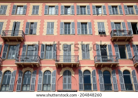 Typical building facade in the city of Nice,Cote d'Azur, France - stock photo