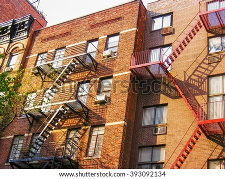 Typical building with fire escapes on the facade in New York City, United States.  - stock photo