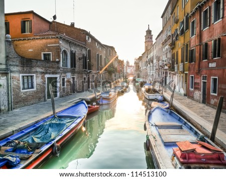 typical canal in venice, italy - stock photo