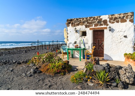Typical Canarian house for tourists on El Golfo beach, Lanzarote, Canary Islands, Spain - stock photo