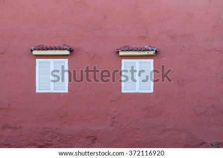Typical canarian house wall with two windows - stock photo