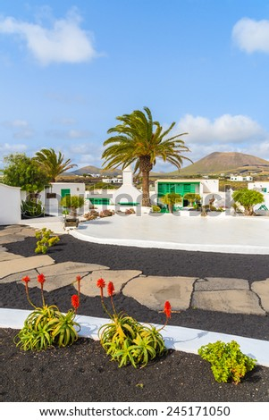 Typical Canarian style buildings and tropical plants, El Campesino Monumento, Lanzarote island, Spain