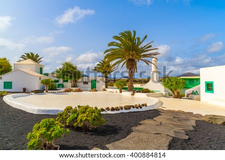 Typical Canarian style buildings and tropical plants, El Campesino village, Lanzarote island, Spain - stock photo