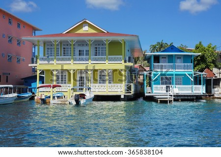 Typical Caribbean colonial homes over the water with boats at dock, Panama, Central America - stock photo