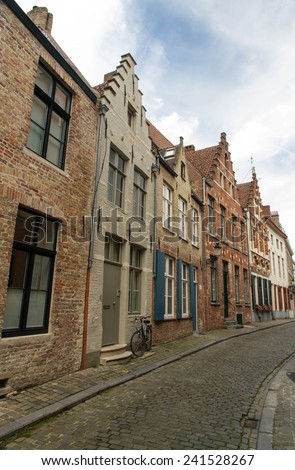 Typical, charming street with bicycle by door. Bruges, West Flanders, Belgium, Europe.