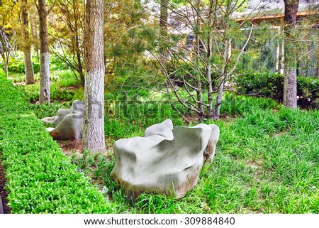 Typical Chinese garden,  park with bizarre rocks. Beijing, China - stock photo
