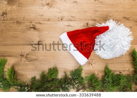 Typical Christmas ornaments in red on old wooden background