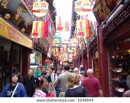 Typical City Street in China.  Shanghai has block after block of stores and shops just like these with tourists galore