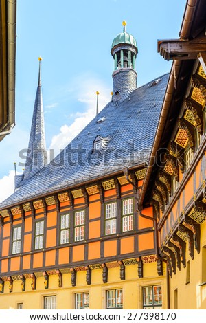 Typical colorful architecture in Wernigerode, a town in the district of Harz, Saxony-Anhalt, Germany - stock photo