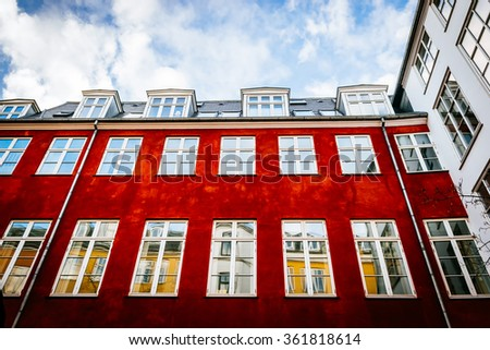 Typical colorful houses and building exteriors in Copenhagen old town, close up on windows and details - stock photo