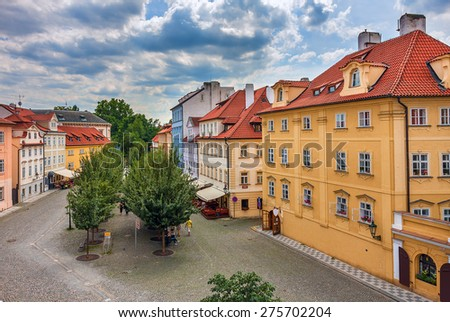 Typical colorful houses with red roofs in Old City of Prague, Czech Republic. - stock photo