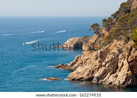 Typical Costa Brava landscape near Tossa de Mar (Girona, Spain), boats in sea - stock photo