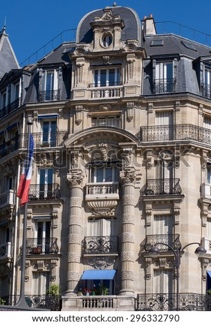 Typical design of Parisian architecture. The facade of french building in modern style with windows and french balconies in Paris, France. - stock photo