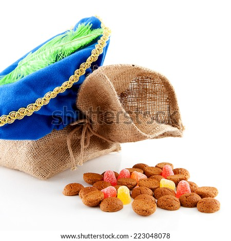 Typical Dutch celebration: Sinterklaas with bag and ginger nuts, ready for the kids in december. Isolated on white background - stock photo
