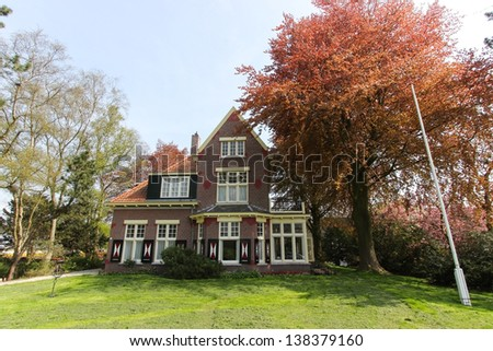 Typical dutch house with red bricks and nice garden in Keukenhof, The Netherlands - stock photo