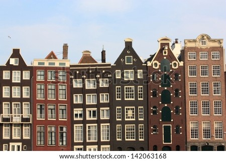 Typical dutch houses along Amsterdam canal in Holland, Netherlands.