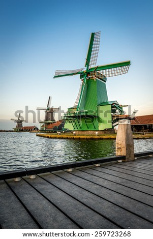 Typical dutch houses and windmills - stock photo
