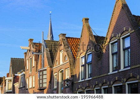 Typical Dutch houses in historical city of Enkhuizen, The Netherlands - stock photo