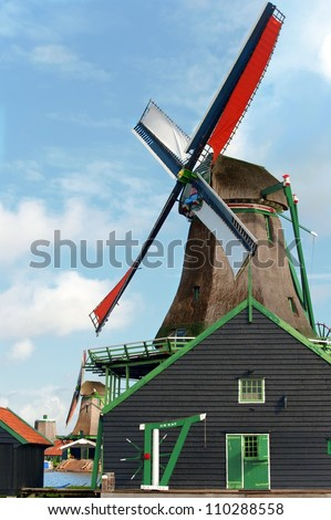 Typical dutch windmill at De Zaanse Schans - stock photo