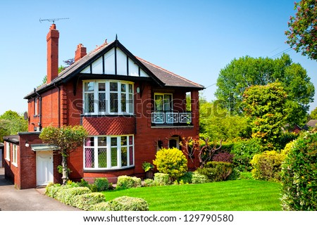 Typical English house in spring garden - stock photo