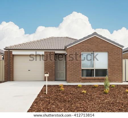 typical  facade of a modern new suburban  house - stock photo