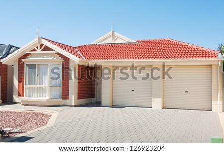 typical  facade of a modern suburban  house - stock photo
