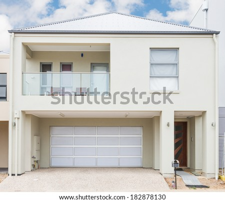typical facade of a modern suburban house at noon - stock photo