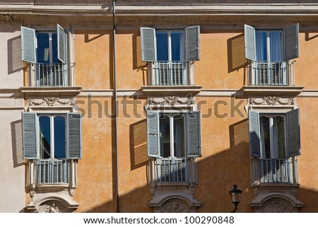 typical facade with windows in rome, italy