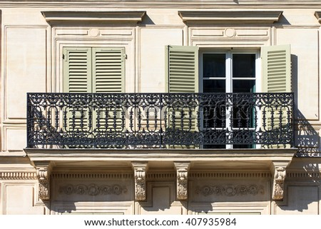 Typical french balcony of an apartment building in Paris, France - stock photo