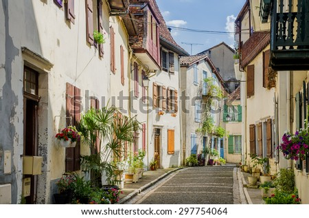 Typical French street in Salies-de-Bearn - stock photo