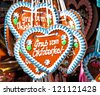 """typical gingerbread hearts at the oktoberfest in munich - """"greetings from the oktoberfest"""" - stock photo"""