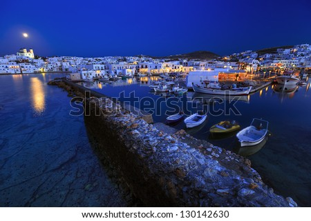 Typical Greek islands' village of Naousa, Paros island, Cyclades, viewed at a full moon rise - stock photo