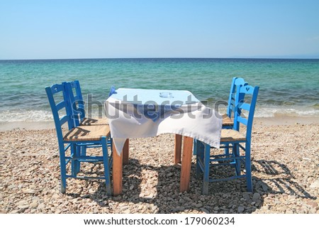 Typical greek tavern - cafe , by the aegean sea - stock photo