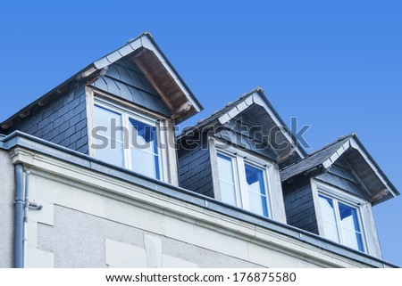 Typical grey blue slate roof, western France - stock photo
