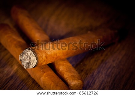 Typical havana cigars on wooden background