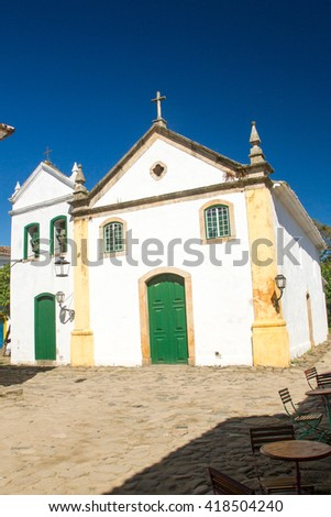 Typical historical colourful wood doors in the colonial downtown of Paraty, Rio de Janeiro, Brazil. - stock photo